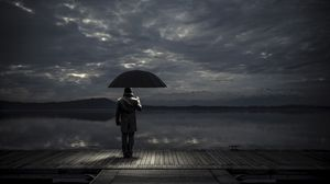 Preview wallpaper man, umbrella, night, pier