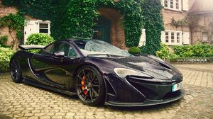 Preview wallpaper mclaren, p1, rain, pavement, side view