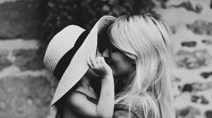 Preview wallpaper mother, child, bw, family, hug, tenderness, hat