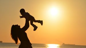 Preview wallpaper mother, child, silhouettes, motherhood, family, sunset, horizon