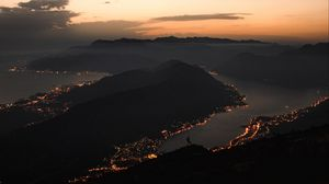 Preview wallpaper mountains, coast, aerial view, city, night, lights