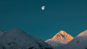 Preview wallpaper mountains, peak, moon, snowy, twilight