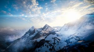 Preview wallpaper mountains, peaks, sky, snowy, view from above, sunlight