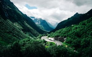 Preview wallpaper mountains, road, car, clouds, norway