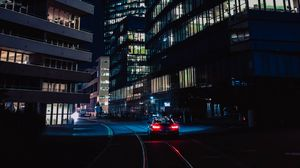 Preview wallpaper night, city, car, movement, buildings