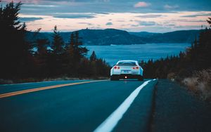 Preview wallpaper nissan gt-r, nissan, rear view, road, movement