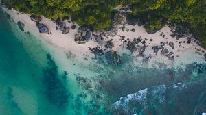 Preview wallpaper ocean, beach, tropics, sand, stones