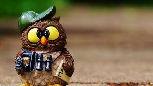 Preview wallpaper owl, figurine, cap, binoculars