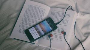 Preview wallpaper phone, headphones, book