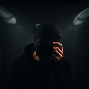 Preview wallpaper photographer, camera, dark, black