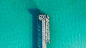 Preview wallpaper pier, ocean, shadow, top view, surface, turquoise