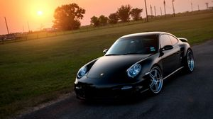 Preview wallpaper porsche, 911, turbo, 997, black, front, sun, grass, reflections