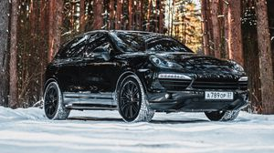 Preview wallpaper porsche, car, black, side view, forest, snow
