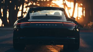 Preview wallpaper porsche, sports car, rear view, black, sunlight