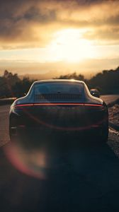 Preview wallpaper porsche, sports car, rear view, black, sunlight, movement