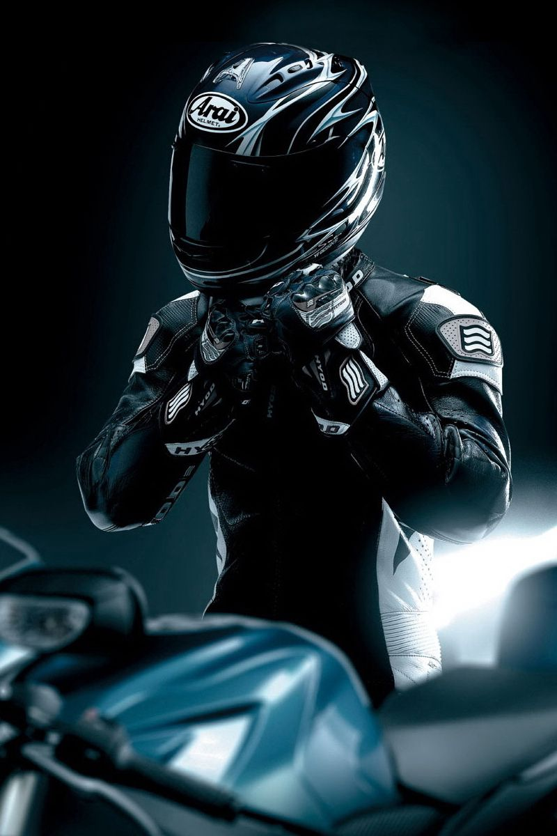800x1200 Wallpaper racer, black, motorcycle, helmet