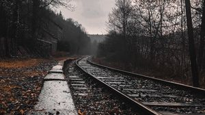 Preview wallpaper railway, rails, forest, cloudy