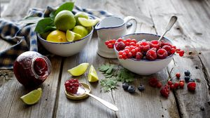 Preview wallpaper raspberries, blueberries, currants, red berries, lemon, lime, citrus, fruit, jam, jar, spoon