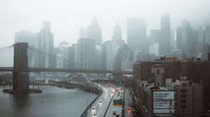 Preview wallpaper road, buildings, aerial view, city, fog