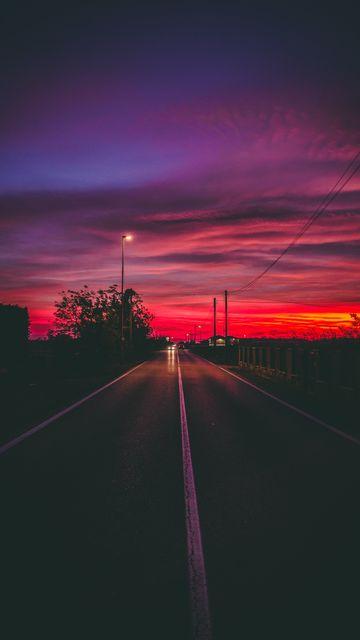 360x640 Wallpaper road, sunset, horizon, marking