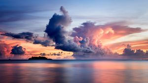 Preview wallpaper sea, clouds, horizon, island, sky, sunset