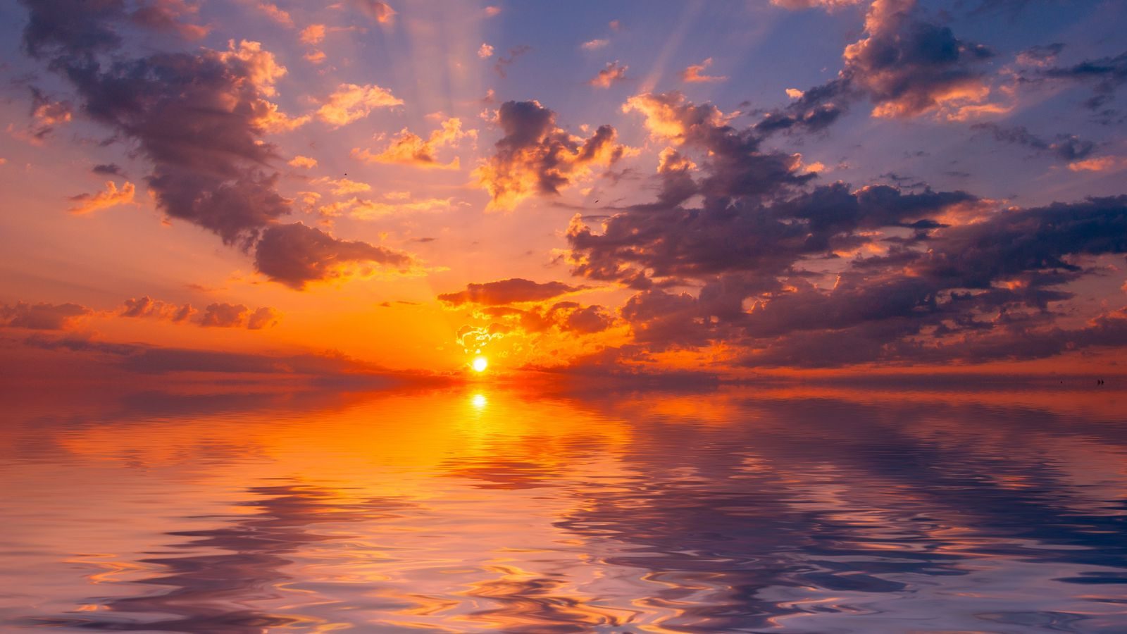 1600x900 Wallpaper sea, sunset, horizon, sun, reflection, clouds