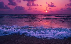 Preview wallpaper sea, sunset, horizon, surf, foam, clouds
