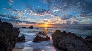 Preview wallpaper sea, sunset, stones, coast