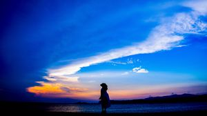 Preview wallpaper silhouette, dark, beach, sea, dusk