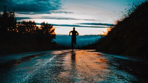 Preview wallpaper silhouette, road, running, asphalt, wet