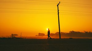 Preview wallpaper silhouette, sunset, pole, wires, walk