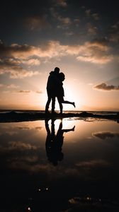 Preview wallpaper silhouettes, couple, hugs, kiss, sunset, dark