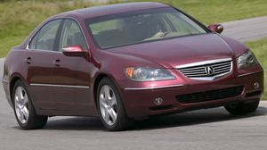 Preview wallpaper acura, rl, sedan, red, front view, style, cars, grass, trees, asphalt