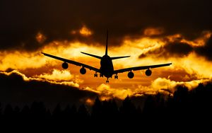 Preview wallpaper airplane, clouds, sky, sunset