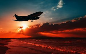 Preview wallpaper airplane, sea, sunset, takeoff, silhouette, sky