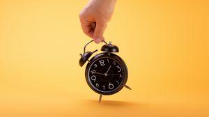 Preview wallpaper alarm clock, clock, time, hand, yellow