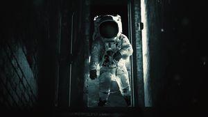 Preview wallpaper astronaut, cosmonaut, gravity, spacesuit, door, dark