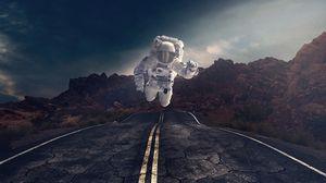 Preview wallpaper astronaut, gravity, road, asphalt, rocks, stones