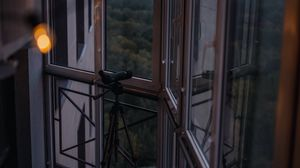 Preview wallpaper balcony, window, telescope, garland, glare
