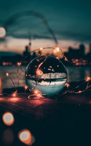 Preview wallpaper ball, garland, glass, transparent, sunset