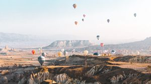 Preview wallpaper balloons, colorful, mountains, rocks, valley
