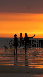 Preview wallpaper beach, promenade, bridge, sea, sunset, waves, children, birds