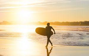 Preview wallpaper beach, surfing, board, sunset, sea, sun