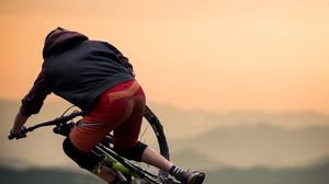 Preview wallpaper bicycle, cyclist, jump, helmet, stunt