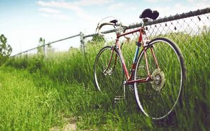Preview wallpaper bicycle, fence, field, grass, summer