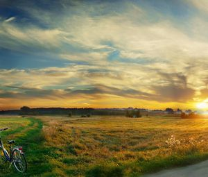 Preview wallpaper bicycle, field, clouds, silence, evening, decline, sky