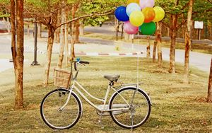 Preview wallpaper bicycle, park, balloons, grass