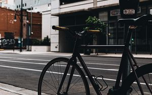 Preview wallpaper bicycle, street, buildings, city