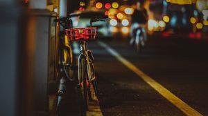 Preview wallpaper bicycle, street, night, glare, bokeh