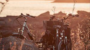 Preview wallpaper bicycle, walk, stone, lake, sunset